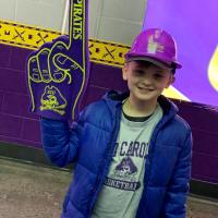 A child with GUC swag at the ECU Men's basketball game
